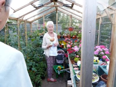Evening garden visit 13 Doreen in her greenhouse